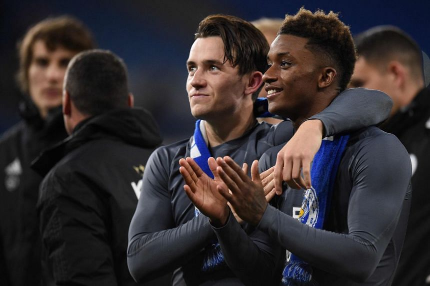 Leicester City's Ben Chilwell (centre) and Demarai Gray applaud fans after the match.
