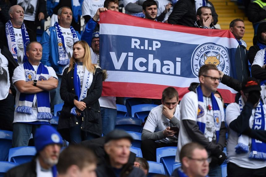 Fans react during a minute's silence to remember the victims of the Leicester City helicopter crash.