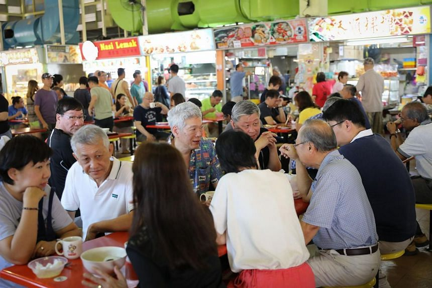 Former presidential candidate Tan Cheng Bock (in blue shirt) having breakfast with Mr Lee Hsien Yang at Block 726 West Coast Market, on Nov 4.