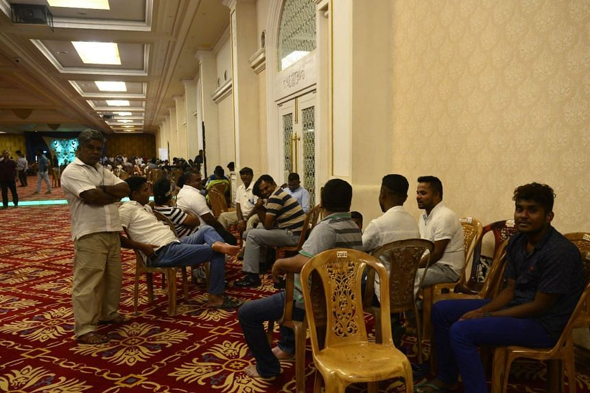 Supporters of ousted Sri Lanka's prime minister Ranil Wickremesinghe gather at the prime minister's official residence in Colombo, on Nov 3, 2018.