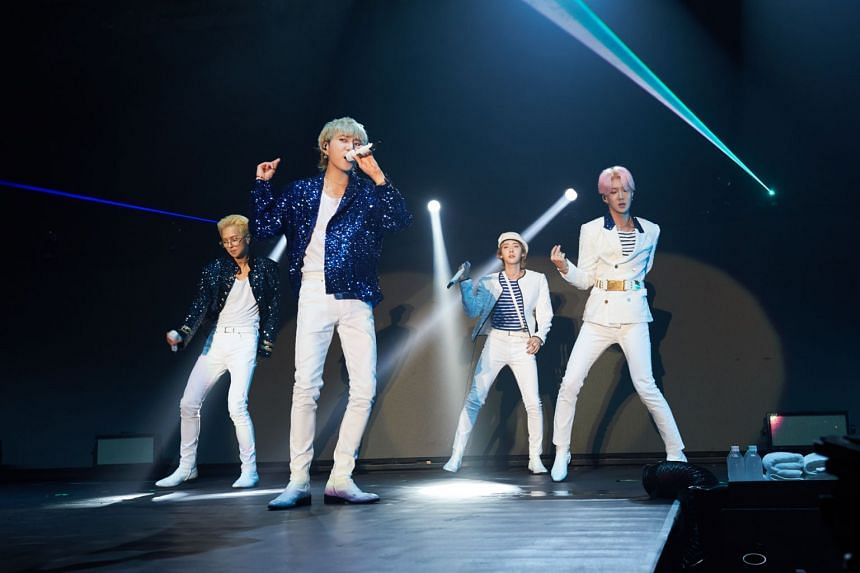 K-pop boyband Winner members (from left) Mino, Yoon, Jinu and Hoony performing at The Max Pavilion on Saturday (Nov 3).