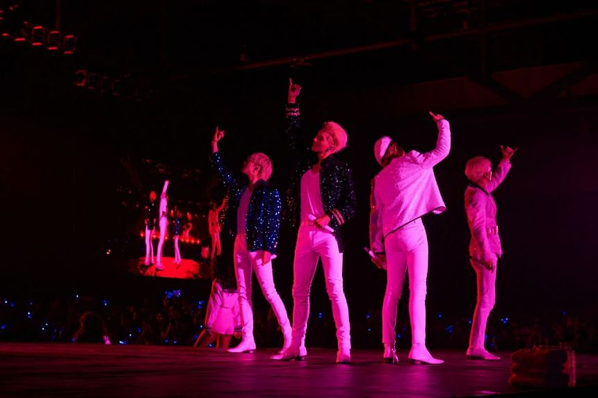 K-pop boyband Winner members (from left) Yoon, Mino, Jinu and Hoony striking a pose at their concert held at The Max Pavilion on Saturday (Nov 3.)
