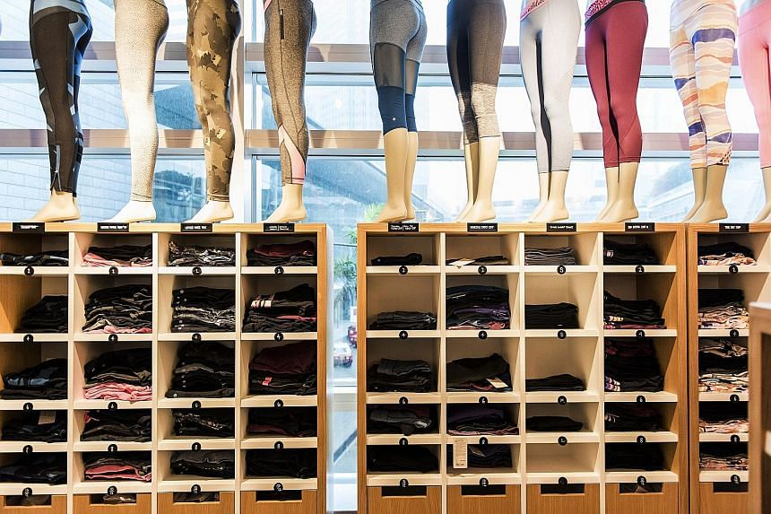 Athletic apparel on display at a Lululemon Athletica store in Hong Kong. Yoga pants are taking the fashion world by storm.