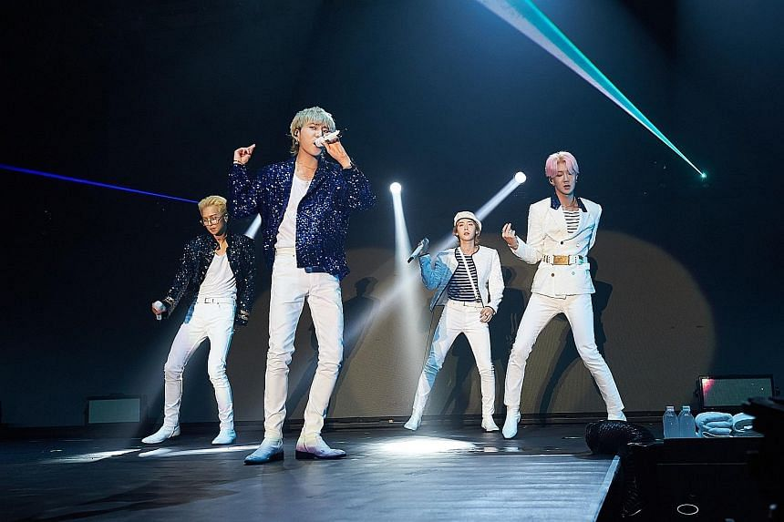 K-pop boyband Winner members (from far left) Mino, Yoon, Jinu and Hoony performing at The Max Pavilion last Saturday.
