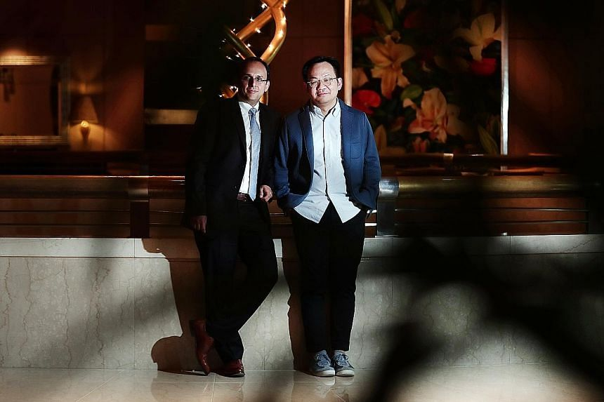 """Professor Kapil R. Tuli (far left) and Mr Mark Wee. Mr Wee said: """"To get people to come out to the malls, they have to offer something else that is experiential and sensory."""""""