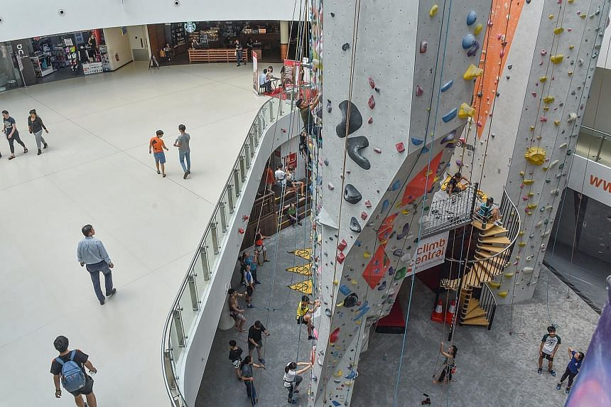 The future of retail includes malls transforming themselves and having standout features, like this rock wall in Kallang Wave Mall that provides a sensory experience for customers, besides providing a selection of stores.