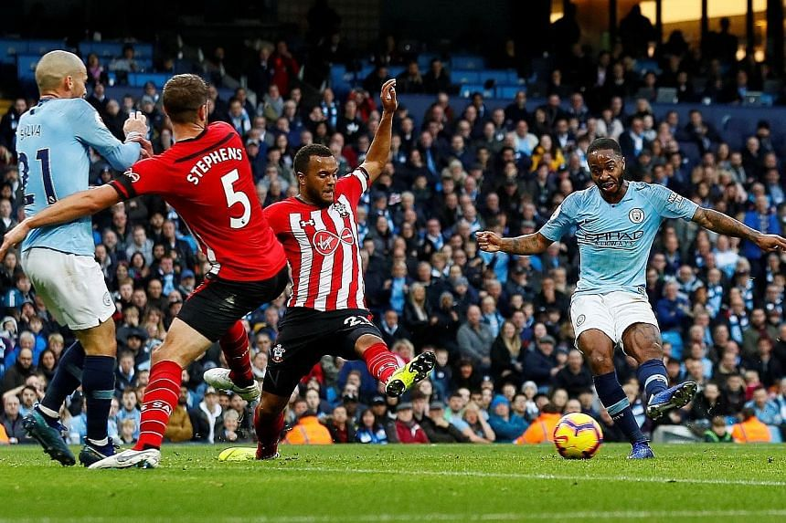 Raheem Sterling scoring Manchester City's fourth goal on the stroke of half-time in their 6-1 rout of Southampton at the Etihad Stadium yesterday. The England international added another in the 67th minute as Pep Guardiola's men moved back to the top