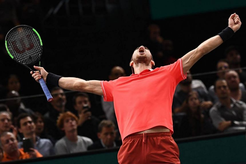 Russia's Karen Khachanov celebrates after winning the men's singles final match on day seven of the ATP World Tour Masters 1000 at The AccorHotels Arena in Paris, on Nov 4, 2018.
