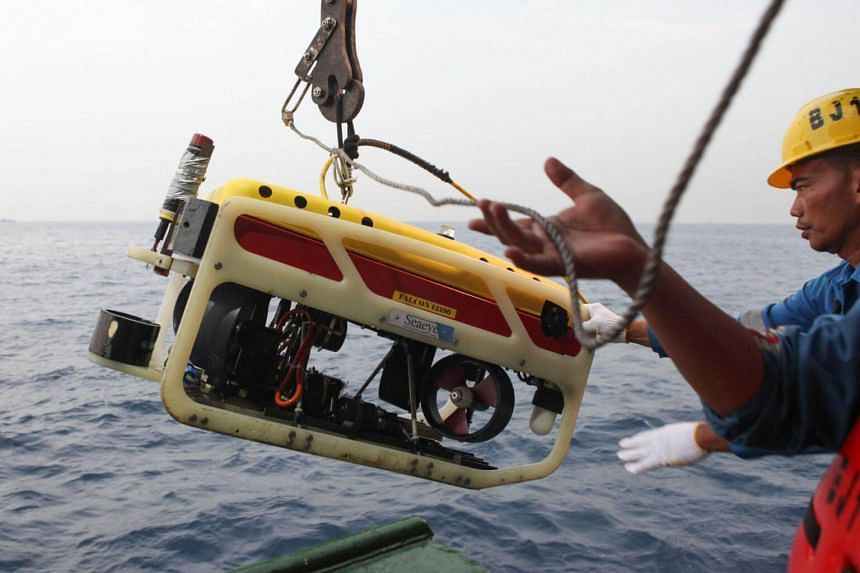 A remotely operated underwater vehicle is prepared for a dive in search of the cockpit voice recorder that was on board the crashed Lion Air flight JT 610.
