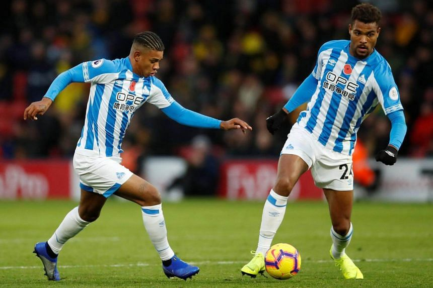 Huddersfield Town's Steve Mounie and Juninho Bacuna in action during their English Premier League match against Watford at Vicarage Road in Britain, on Oct 27, 2018.