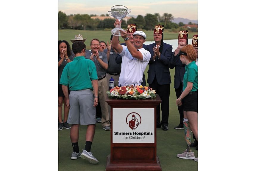 Bryson DeChambeau was awarded the champion's trophy after winning the Shriners Hospitals for Children Open at TPC Summerlin on Nov 4, 2018.