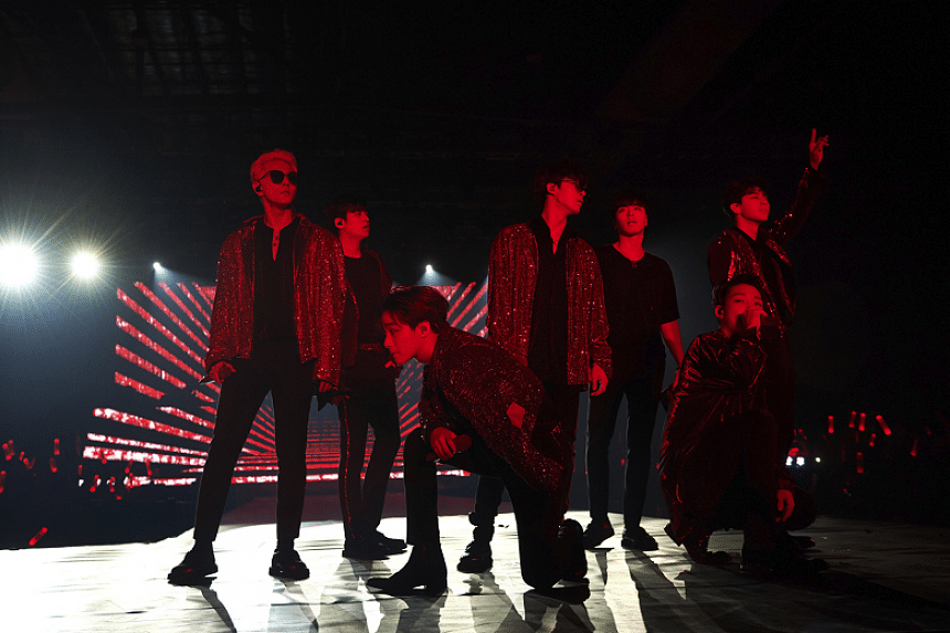 K-pop boyband iKon (from left) - Donghyuk, Chanwoo, Jinhwan, B.I, Junhoe, Bobby and Yunhyeong - opening their Sunday (Nov 4) show at The Max Pavilion.