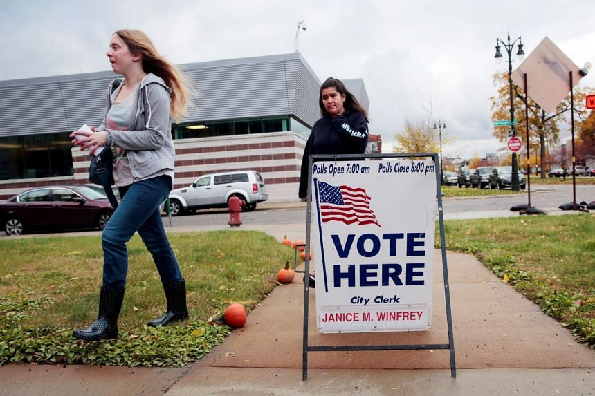 Voters in Detroit, Michigan, show up to cast their ballots in the US midterm elections.