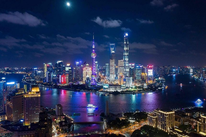 Pudong, Shanghai's financial district, at night. China's financial services sector has been especially hard-hit by subdued market conditions. Beijing has stepped up liquidity support for the economy by cutting the level of cash banks must hold as res