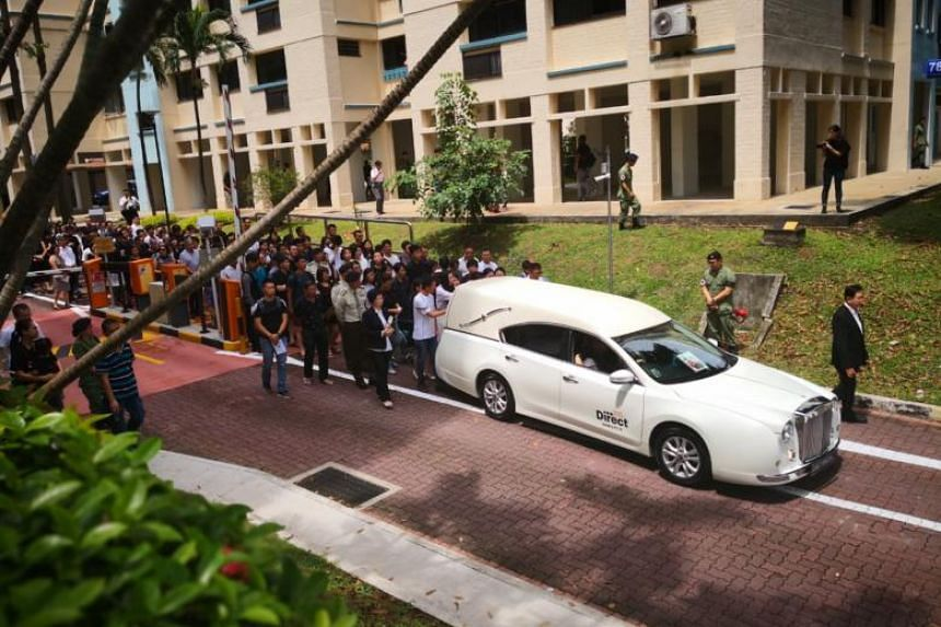 Corporal First Class Liu Kai's family was visibly emotional as the hearse carrying his casket departed for Mandai Crematorium.