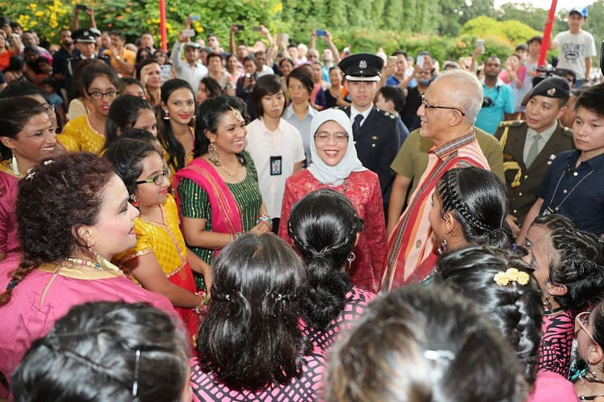 President Halimah Yacob and her husband Mohamed Abdullah Alhabshee at the Deepavali Istana Open House on Nov 6, 2018.