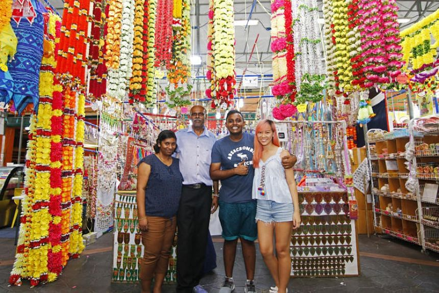 Mr R. Jayaselvam (second from left), his wife Anushia Panchalingham, their son J. Jayakrishen and his girlfriend Jazreel Hoo. Demand for the garlands has doubled since Mr Jayaselvam launched a mobile application for his business last year.