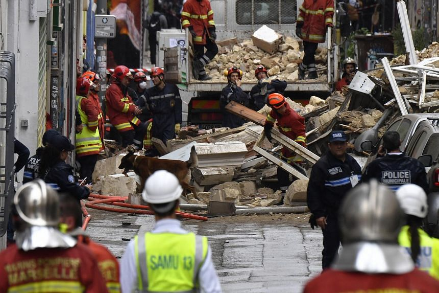 People at the site where two buildings collapsed, resulting in at least two people injured, on Nov 5, 2018 in Marseille.