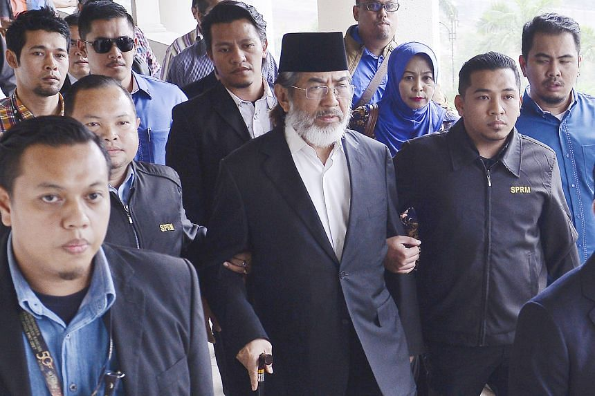 Former Sabah chief minister Musa Aman arriving at the Kuala Lumpur Court Complex yesterday to answer charges of corruption against him. He was granted bail of $660,000 with two sureties and ordered to surrender both his civil and diplomatic passports