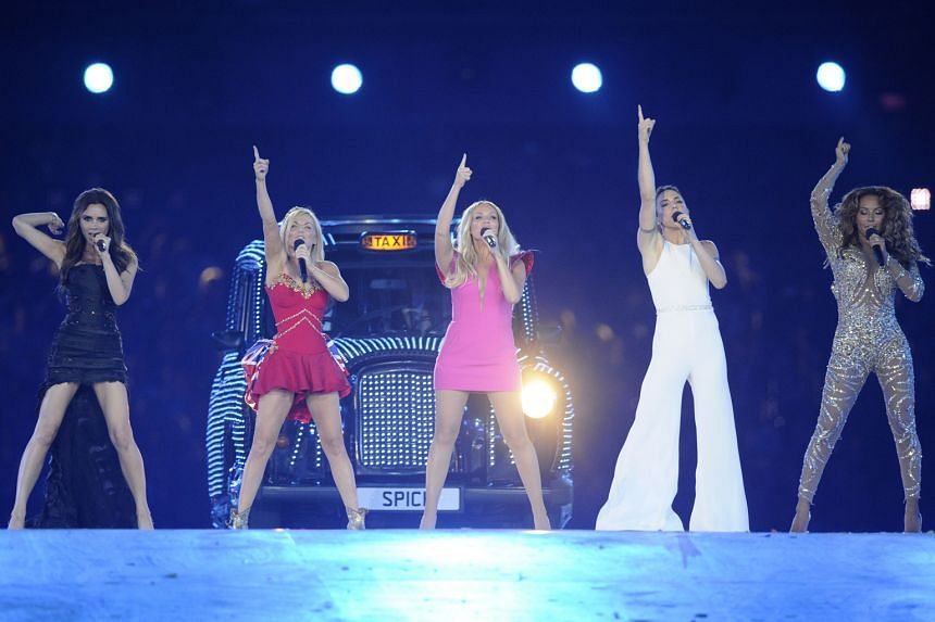 The Spice Girls' (from left) Victoria Beckham, Geri Halliwell, Emma Bunton, Melanie Chisholm and Melanie Brown at the London 2012 Olympic Games (above).