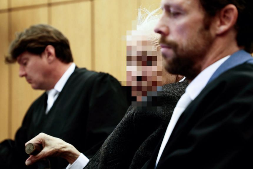 Defendant Johann R (centre) with his lawyers in court on Nov 6, 2018.