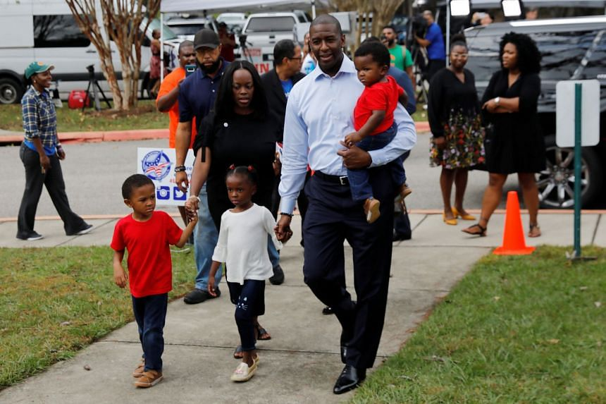 Democratic gubernatorial candidate Andrew Gillum walks with his family to vote in Tallahassee, Florida.
