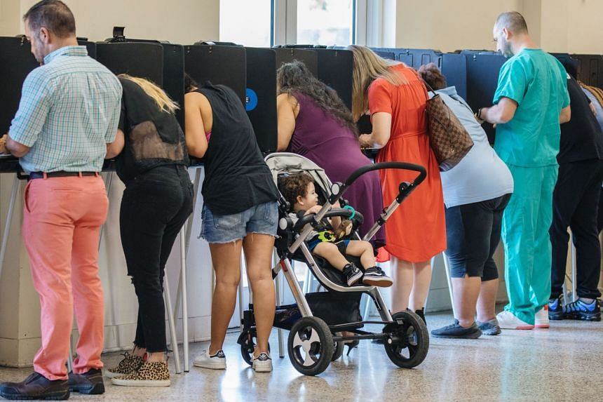 Voters cast ballots at a polling station in Miami, Florida.