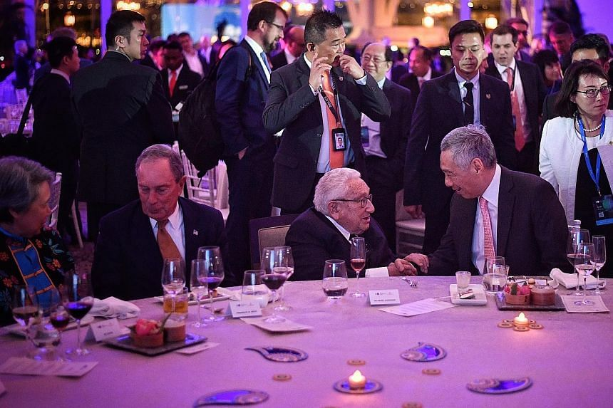 Prime Minister Lee Hsien Loong greeting Dr Henry Kissinger at a welcome dinner at the Bloomberg New Economy Forum last night. With them are the PM's wife, Mrs Lee, and Bloomberg chief executive Michael Bloomberg. When asked at a dialogue with Bloombe