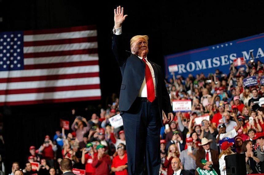 United States President Donald Trump waving to supporters at a campaign rally on Monday in Cape Girahere, Missouri. He continued to bash individual Democrats and fan fears over immigration.
