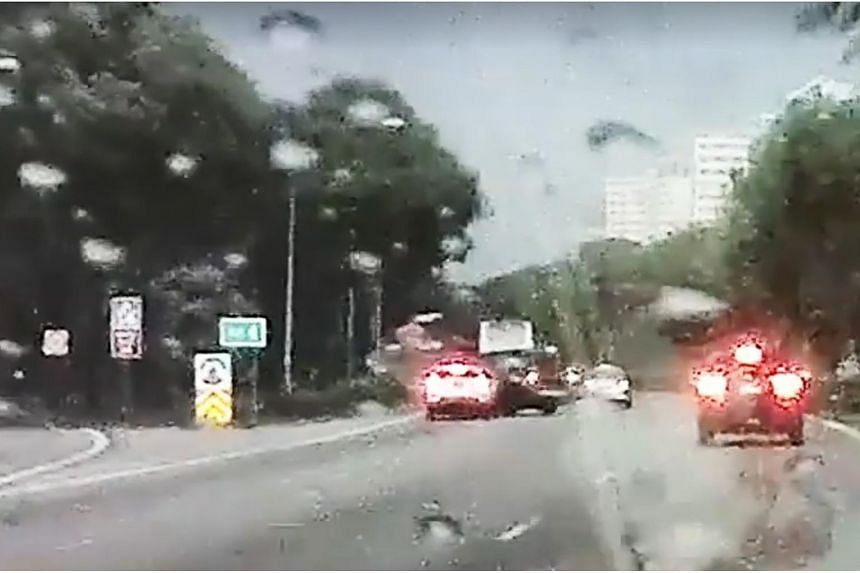 In a Facebook video, a green van is seen veering suddenly across two lanes to the leftmost lane. It collides into a white car and both vehicles overturn.