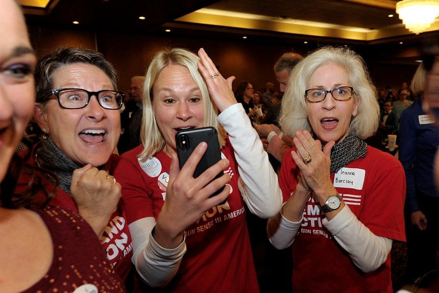 Democrats celebrate after candidate Laura Kelly was declared the winner over Kris Kobach at her election night party in Topeka, Kansas, on Nov 6, 2018.