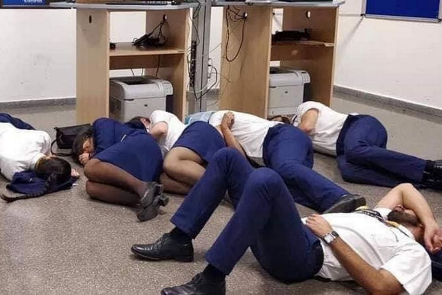 According to Ryanair, the photo was staged, and no crew members slept on the floor when 28 Ryanair crew members were stranded in Malaga, Spain, after their Porto-bound flights were diverted on Oct 14, 2018.