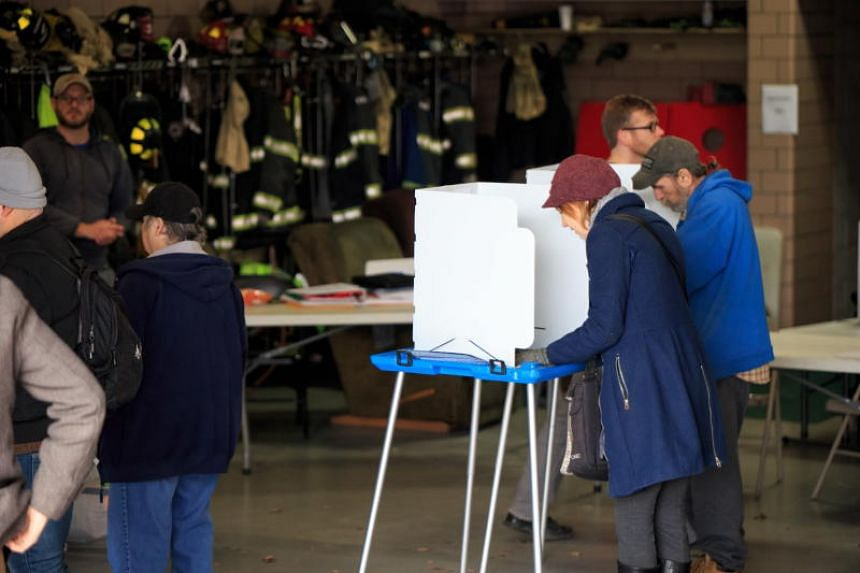 Indiana voters casting their ballots at a fire station in Indianapolis, Indiana, on Nov 6, 2018.