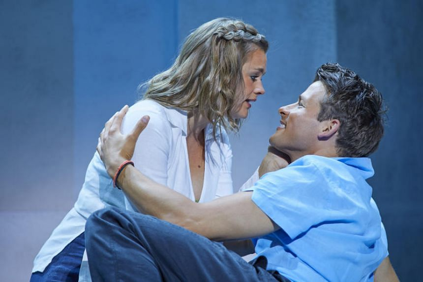Lucy May Barker as Sophie and Phillip Ryan as Sky in the musical, Mamma Mia!. The couple first met at the auditions for the musical in 2015, and plan to get married in 2020.