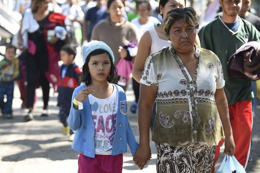 Central American migrants - mostly Hondurans - heading to the US arrive at a temporary shelter in Mexico City.