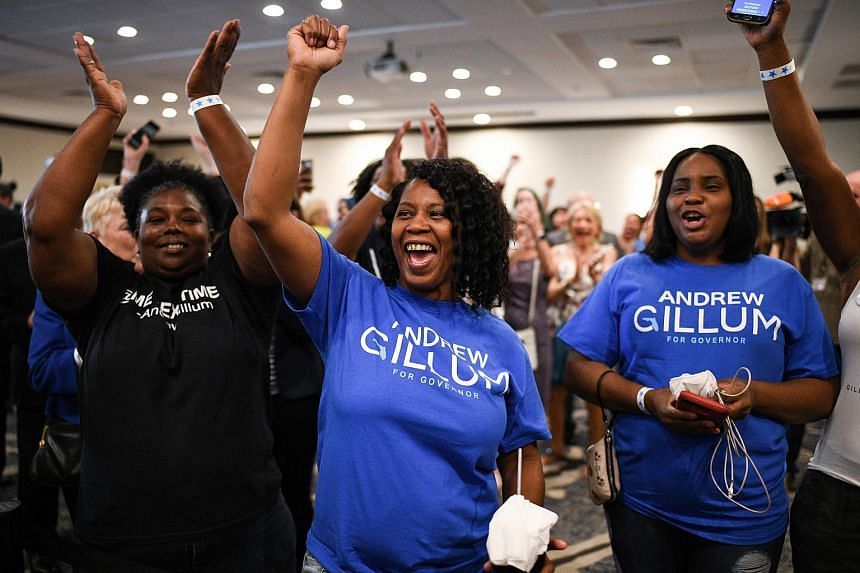 Crowds who were gathered at an election night rally for Mr Andrew Gillum erupted in cheers when cable news networks reported the ballot measure had crossed the 60 per cent threshold it needed to pass.