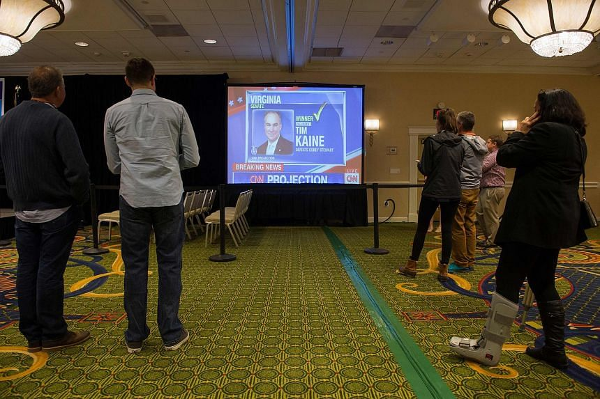 Supporters of Virginia Democratic Congressional candidate, Jennifer Wexton, watch election results come in at her election watch party in Dulles, Virginia on Nov 6, 2018.