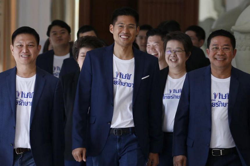 Thai Raksa Chart Party's leader Preechapol Pongpanich (centre) arrives for the first party meeting in Bangkok, Thailand, on Nov 7, 2018.