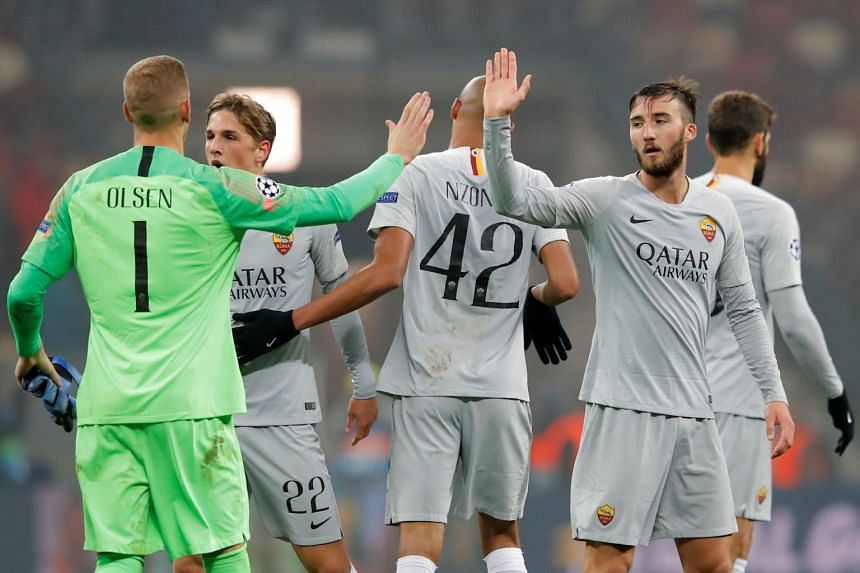 Roma's Robin Olsen and Bryan Cristante celebrate after the match.