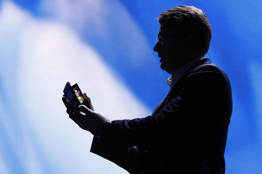 Justin Denison, senior vice-president of mobile product marketing, speaks during the unveiling of Samsung's new foldable screen smartphone.