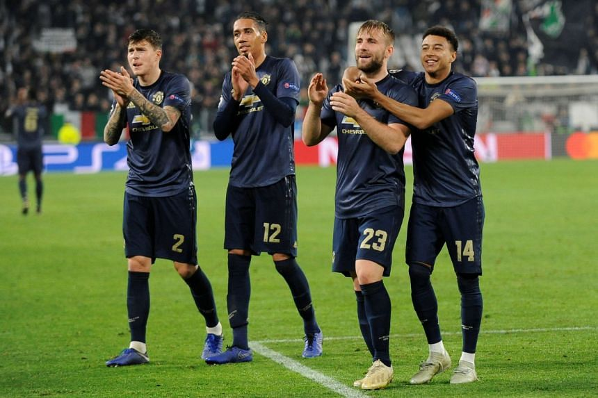 Manchester United's Victor Lindelof, Chris Smalling, Luke Shaw and Jesse Lingard applaud fans after the match.