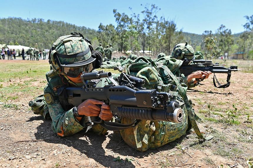 Soldiers from 1st Guards Battalion rehearsing the procedures they have to follow after exiting a helicopter, during Exercise Wallaby.