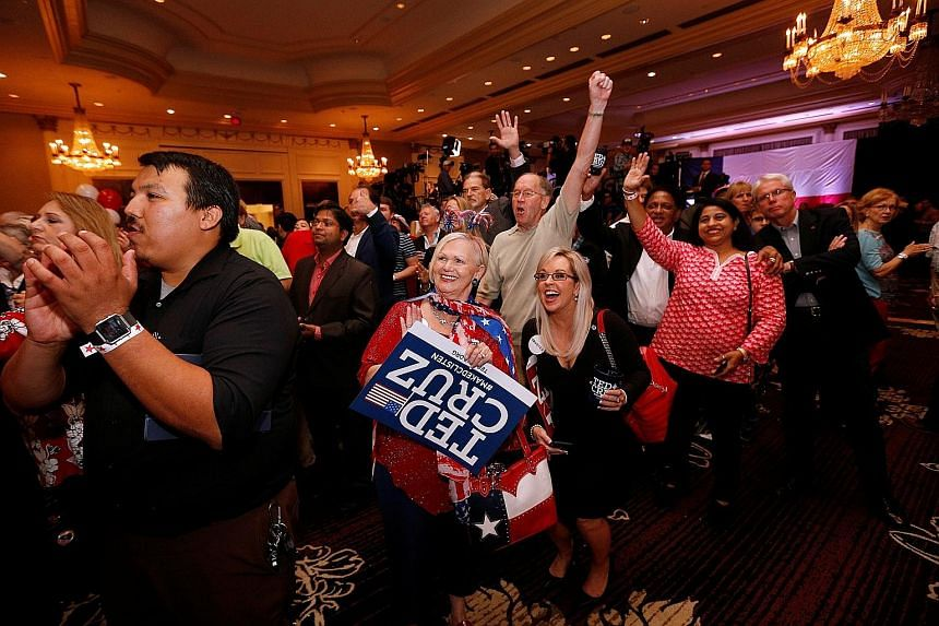 Supporters cheering during an election night party in Houston for Republican Senator Ted Cruz, who retains his seat in Texas.