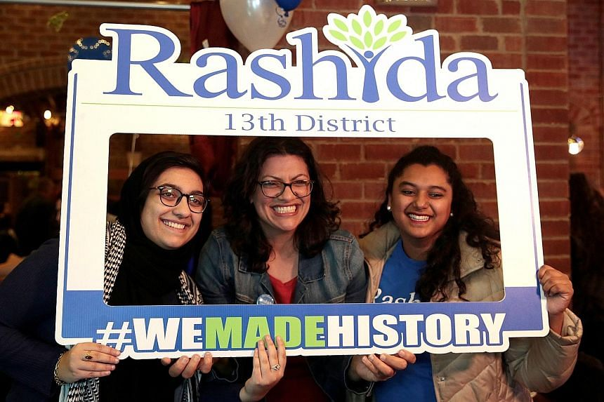 Ms Rashida Tlaib (centre of picture on the left) and Ms Ilhan Omar (above) make history as the first Muslim women elected to US Congress.