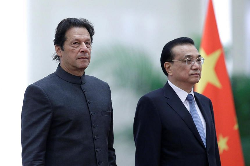 Pakistani Prime Minister Imran Khan and China's Premier Li Keqiang attend a welcome ceremony at the Great Hall of the People in Beijing, China, on Nov 3, 2018.