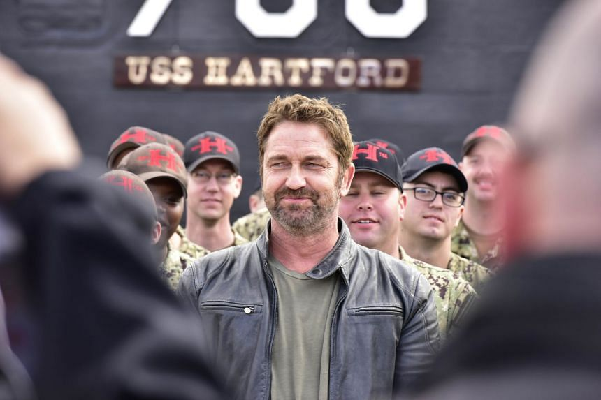 Actor Gerard Butler and USS Hartford crew at the Battenberg Cup Presentation to USS Hartford during a Hunter Killer cast visit to the Naval Submarine Base New London, on Oct 20, 2018.