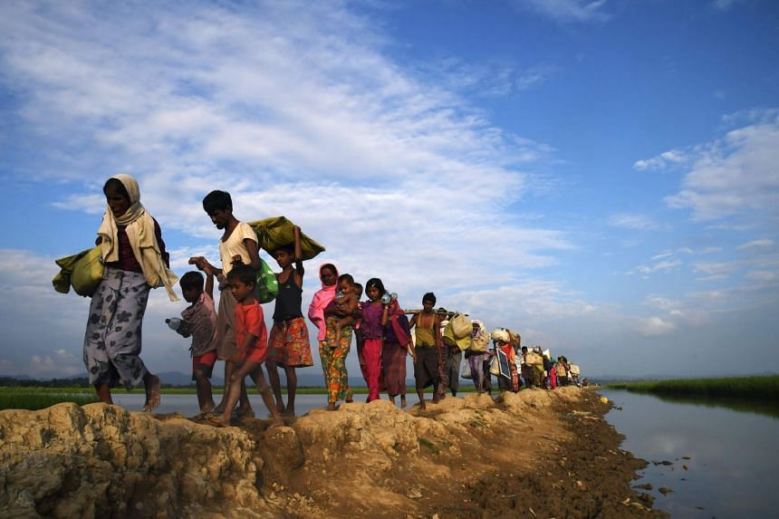 Rohingya Muslim refugees make their way to a Bangladesh refugee camp in this 2017 photo.