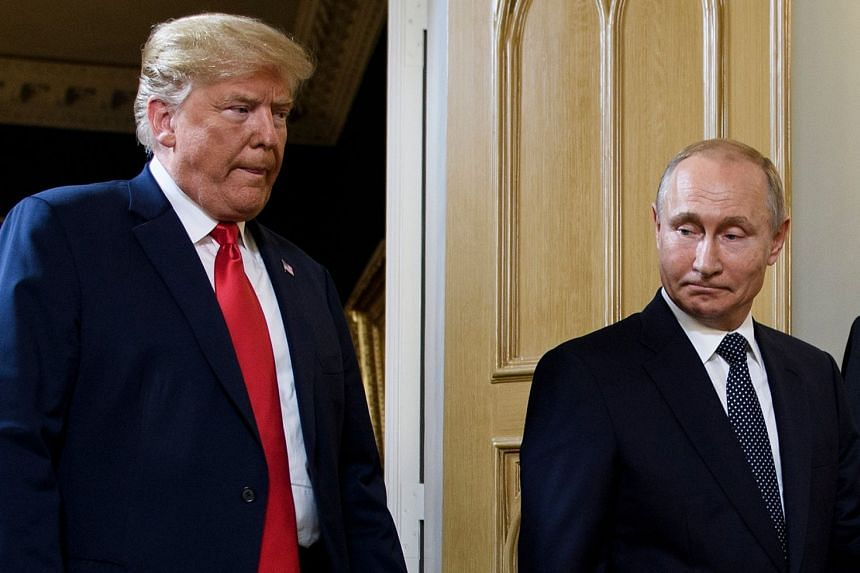 Trump (left) and Putin arrive for a meeting in Helsinki, Finland, in July 2018.
