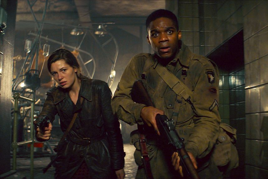 Jovan Adepo (right) and Mathilde Ollivier in a scene from the horror movie Overlord.