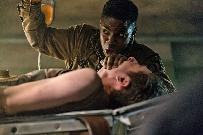 Overlord is directed by Julius Avery (above left), produced by J.J. Abrams (right) and stars Jovan Adepo (top).